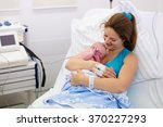 mother giving birth to a baby.... | Shutterstock . vector #370227293