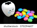 Small photo of Tooth decay is crying with emotions sugar coated chocolate on the side. On a black background