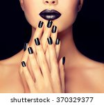beautiful girl showing black... | Shutterstock . vector #370329377