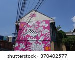 Small photo of BANGKOK, THAILAND - JANUARY 31, 2016: A mural artwork on a building exterior of the Chinese style shophouse by Aitch?, a Romanian street artist, which is part of the Bukruk 2016 Urban Art Festival.