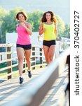 two cute young girls jogging... | Shutterstock . vector #370402727