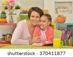 daughter and mother reading the ... | Shutterstock . vector #370411877
