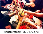 clinking glasses with alcohol... | Shutterstock . vector #370472573