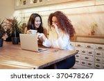 attractive girl friends discuss ... | Shutterstock . vector #370478267