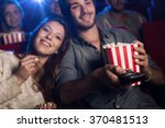young man watching a movie with ... | Shutterstock . vector #370481513