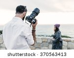 photographer doing a photo... | Shutterstock . vector #370563413