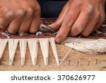 Man Hands Weaving A Traditiona...