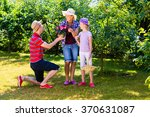 family in garden | Shutterstock . vector #370631087