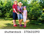 family in garden | Shutterstock . vector #370631093