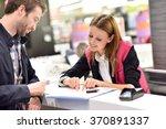car rental assistant giving...   Shutterstock . vector #370891337