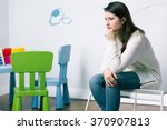 Sad Woman Sitting In Baby Room...