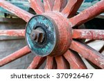 The Old Wooden Wheel On A Meta...