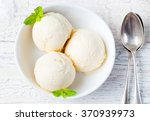 Stock photo vanilla ice cream with mint in bowl homemade organic product top view 370939973