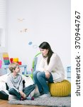 young babysitter and boy... | Shutterstock . vector #370944767
