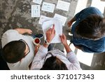 man pointing at document while ... | Shutterstock . vector #371017343