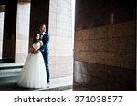 wedding couple under high tech... | Shutterstock . vector #371038577