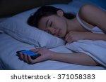 Asian Woman Asleep While...
