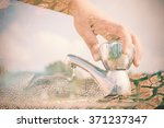 woman hand shut the faucet with ... | Shutterstock . vector #371237347