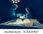 surgeons team working with... | Shutterstock . vector #371334967
