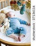 seven month old baby boy sound... | Shutterstock . vector #37136116