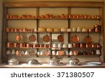 old copper  pots and pans on... | Shutterstock . vector #371380507