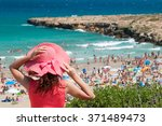 tourist girl with a pink hat... | Shutterstock . vector #371489473