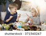 painting easter eggs with... | Shutterstock . vector #371560267