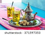 moroccan mint green tea in two... | Shutterstock . vector #371597353