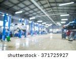 auto repair shop in bokeh ...   Shutterstock . vector #371725927