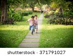 little sibling boy playing... | Shutterstock . vector #371791027