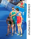 Small photo of STOCKHOLM - AUG 23, 2015: Tired triathletes Gomez, Schoeman, and Bailie after the finish after the finish at the Men's ITU World Triathlon series event August 23, 2015 in Stockholm, Sweden