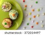 colorful cupcakes with cream ... | Shutterstock . vector #372014497