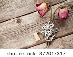 Two Old Chained Roses Symboliz...