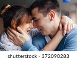 closeup of hugging couple | Shutterstock . vector #372090283