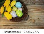 easter eggs in the nest  | Shutterstock . vector #372172777
