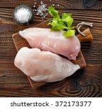 raw chicken fillets on wooden... | Shutterstock . vector #372173377