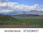 country road into the mountains.... | Shutterstock . vector #372228427