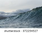 Surf  A Wave Cresting And...
