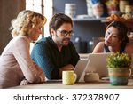 three businesspeople working at ... | Shutterstock . vector #372378907