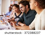 business team having meeting in ... | Shutterstock . vector #372388237
