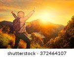 happy traveler with backpack... | Shutterstock . vector #372464107