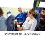 group of happy passengers in... | Shutterstock . vector #372480637