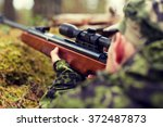 soldier or hunter shooting with