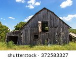 A Weathered Old Barn In A Fiel...