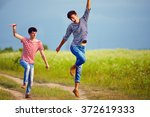 happy male couple running... | Shutterstock . vector #372619333
