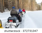athletes on a snowmobile moving ... | Shutterstock . vector #372731347