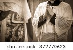 Small photo of Artistic vintage sepia edit of an altar boy or a mass server in surplice during the traditional tridentine latin catholic mass