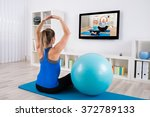 young pregnant woman doing yoga ... | Shutterstock . vector #372789133