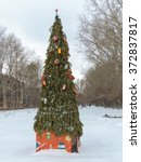 christmas tree in the yard | Shutterstock . vector #372837817