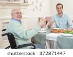two men have a family diner in